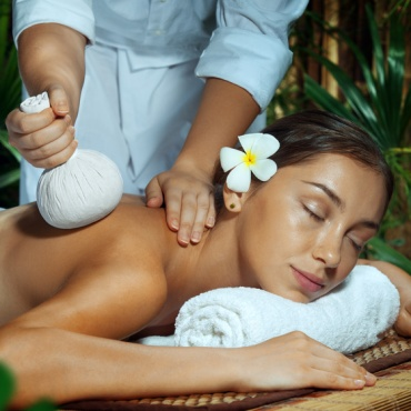 Relaxing thai massage with thai herbs